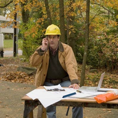 contractor on phone looking at plans