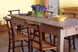 rustic limed looking table in a dining room