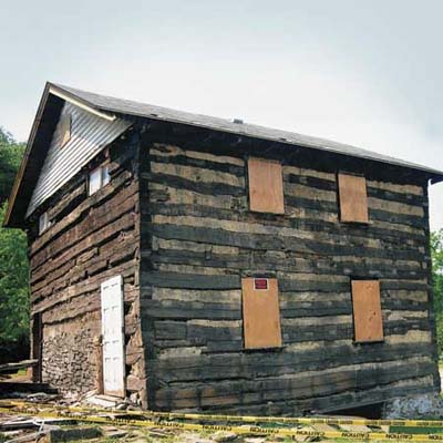 a log cabin in Elizabeth Township, PA that is still up for sale