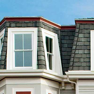 mansard roof topped with slate-look laminated shingles