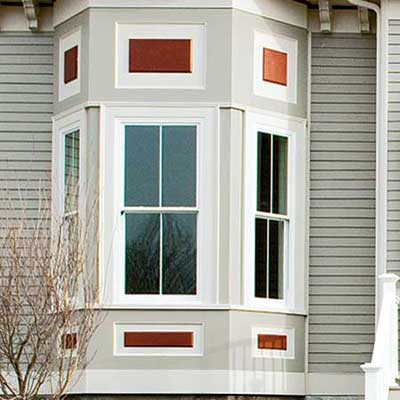 muted color palette of taupe weatherproof fiber-cement siding and white trim