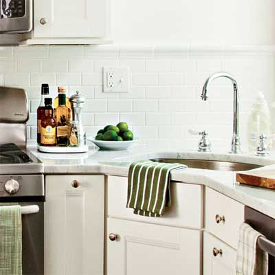 light color cabinets backsplash and walls help reflect light into the space