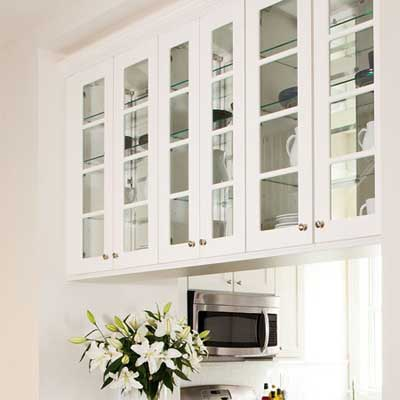 dual-sided cabinets with glass doors were installed in this kitchen
