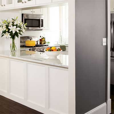 half wall creates easy access between kitchen and dining space