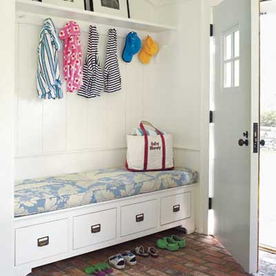 mudroom with storage bench and coat hooks