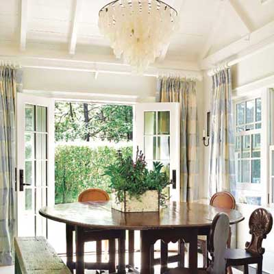 cottage style dining room with vaulted ceiling and french doors