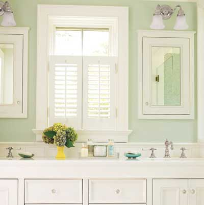 bright bathroom with vintage accents and white cabinetry
