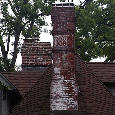 efflorescence on brick chimney