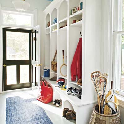 entryway mudroom with runner and cubbies