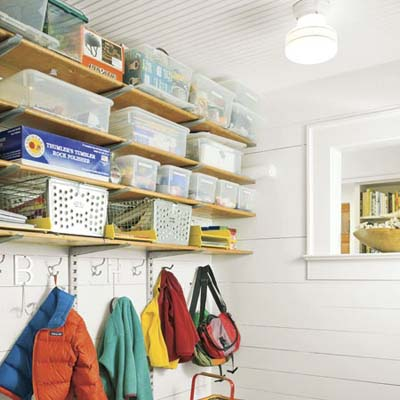 mudroom with shelving, coat hooks and bench