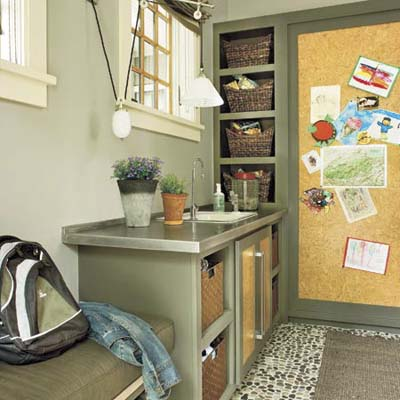 mudroom with sink, pantry and storage