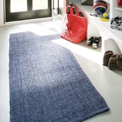 blue sisal runner rug on mudroom floor