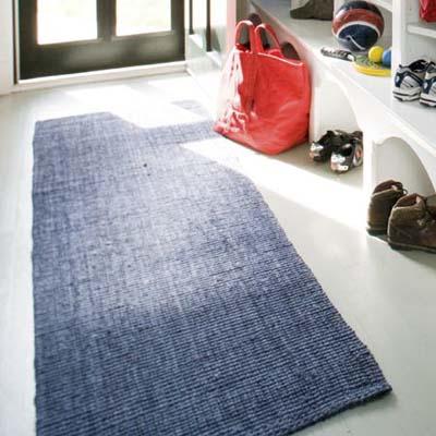 blue sisal runner rug on mudroom floor