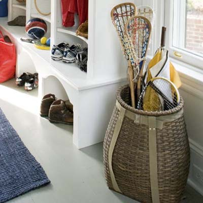 oversize basket holds lacrosse sticks and umbrellas