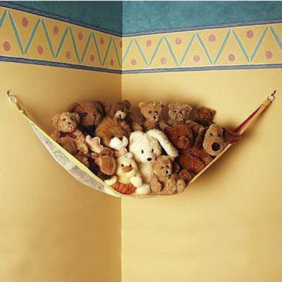 toy hammock filled with stuffed animals