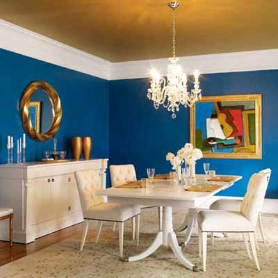 blue dining room with gold painted ceiling