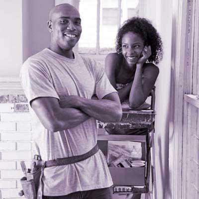 woman gazing at man in tool belt