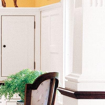 home office with traditional colonnades and wainscoting