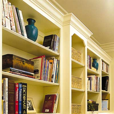 wall of bookshelves in home office