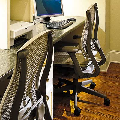 home office with ergonomic desk chairs