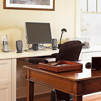 home office with writing desk and computer desk