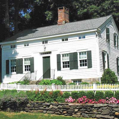exterior of white saltbox home with wide siding