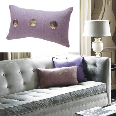 gray toned living room with lavender colored pillow