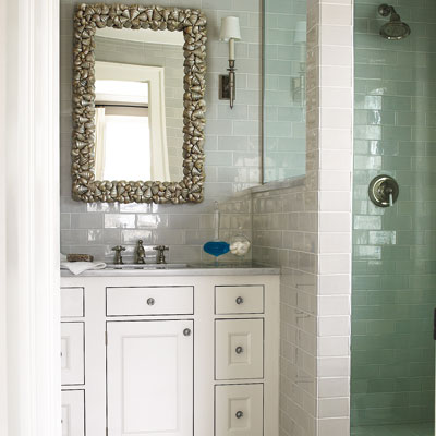 bathroom with white tiled walls and white vintage vanity