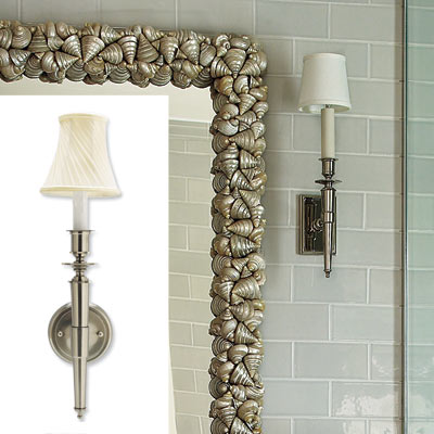 wall sconces in white tiled bathroom