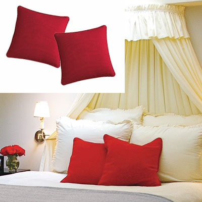 feminine bedroom with red throw pillows