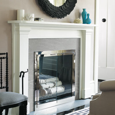 fireplace with white mantle and gray toned walls