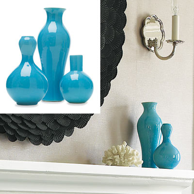 blue vases on fireplace mantel in serene home