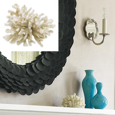 white coral centerpiece on fireplace mantel in serene home