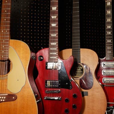 guitars stored in home office hobby nook