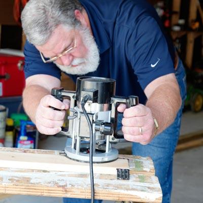 man milling poplar plywood