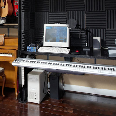computer and music equipment stored in office storage area
