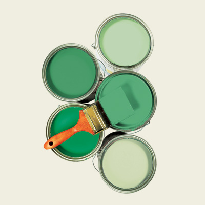 multiple cans of green paint