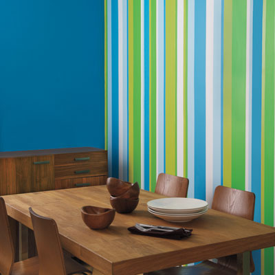dining room with colorful painted striped accent wall