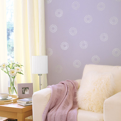 living room with lilac painted walls and stamped motif