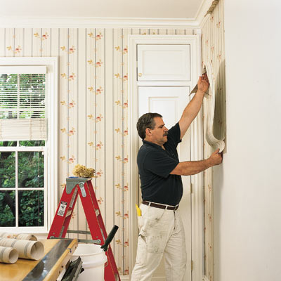 man installing wallpaper