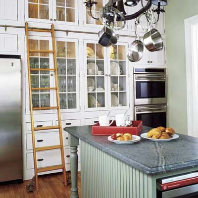 kitchen upgrade featuring a library-style ladder used to access top kitchen cabinets