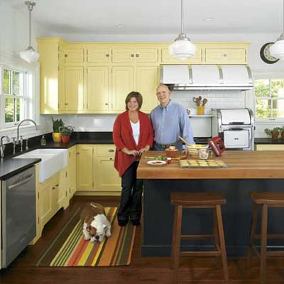 couple and dog in their newly remodeled vintage look italianate kitchen