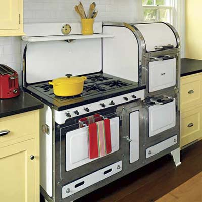 rebuilt magic chef gas range and custom cabinets with chrome hardware in this remodeled italianate kitchen