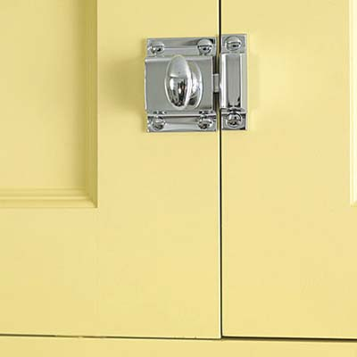 old-fashioned latches on the uppermost cabinets in this remodeled italianate kitchen 