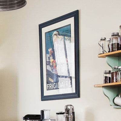 framed vintage poster in retro modern kitchen