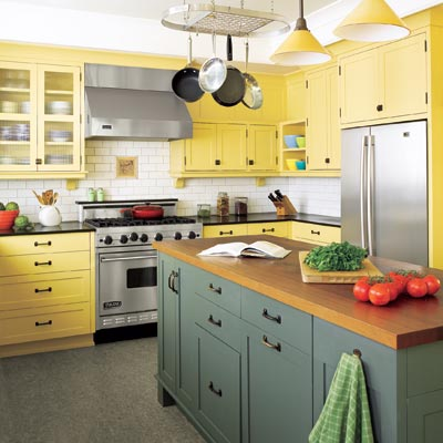 traditional style kitchen with yellow cabinets dark green island and