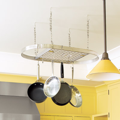 metal ceiling pot rack in traditional kitchen with yellow cabinets