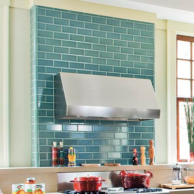 modern industrial kitchen with teal tiled wall runner and backsplash