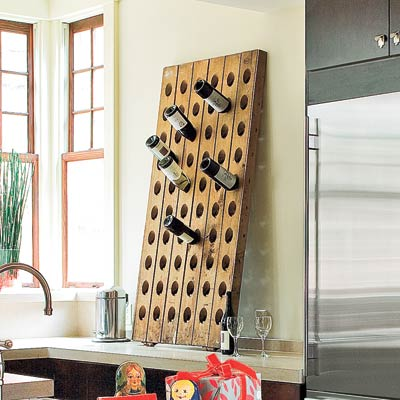 modern industrial kitchen with vintage wood riddling wine rack