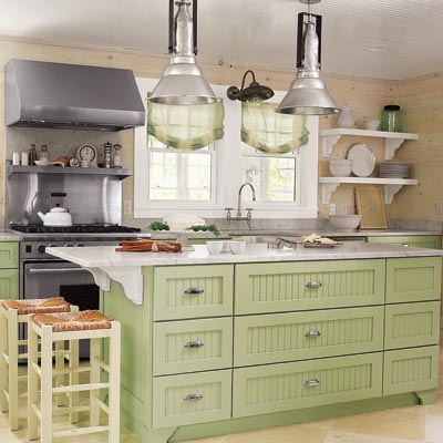 Farmhouse Kitchen With Green Cabinetry And White Washed Walls